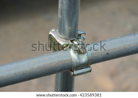 SELANGOR, MALAYSIA -FEBRUARY 26, 2015: Scaffolding connector detail at the construction site. The connector bind two scaffolding or safety pipe together.
