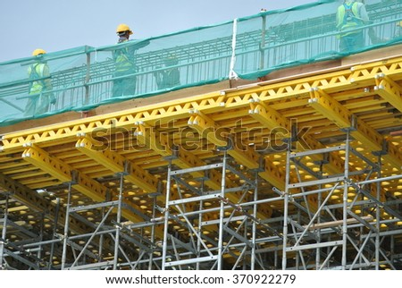 SELANGOR, MALAYSIA â?? FEBRUARY 11, 2015: Scaffolding used to support a platform or form work. It is act as the temporary structure at the construction site for construction workers to work.