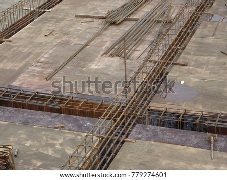 SELANGOR, MALAYSIA -JANUARY 18, 2017: Slab steel reinforcement bar laid on top of timber form work to form part of the floor slab structure after poured with concrete.