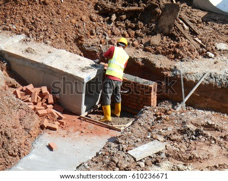 SELANGOR, MALAYSIA -JANUARY 18, 2017: Underground precast concrete box culvert drain under construction at the construction site. It is used to channel storm water to the nearest monsoon drain.