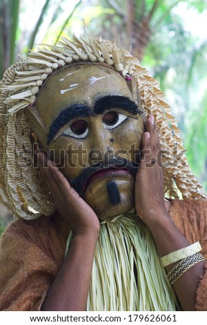 SELANGOR,MALAYSIA - 1 MARCH : An unidentified men wearing wooden masks perform, the Mahyin Jo-oh dance during the Ari Moyang celebration. on March 1, 2014 in Selangor, Malaysia.  - stock photo