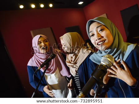 Selangor, Malaysia - October 12, 2017 : Muslims women are singing together in studio at Seri Kembangan.