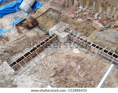 SELANGOR, SEPTEMBER 17, 2015: Building ground beam reinforcement bar and form work fabricated at site by construction workers. Concrete will be four into it after satisfied by engineer.