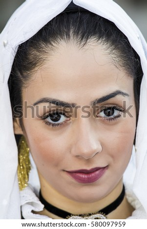 SELARGIUS, ITALY - September 11, 2016: Former marriage Selargino - Sardinia - portrait of a beautiful girl in traditional Sardinian costume