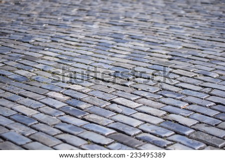 Select focus and blur of colonial brick street in Old San Juan, Puerto Rico - stock photo