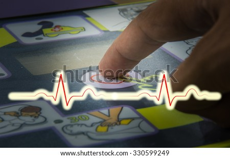 select focus finger push shock on automated external defibrillator dark tone - stock photo