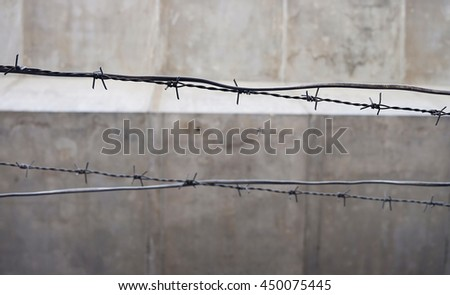 select focus old and rusty barbed wire on the fence - stock photo