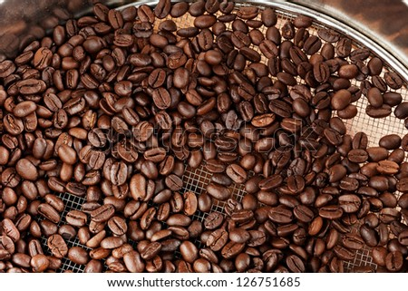 Selected Coffee Beans In Sieve - stock photo