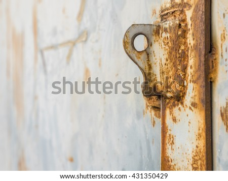 Selected focus at hole of lock. Old and rusty iron ring on gate of warehouse. lock background of metal gate. - stock photo