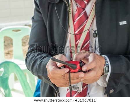selected focus at security hand while setup radio channel - stock photo