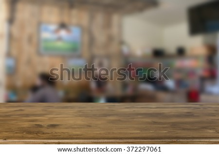Selected focus empty brown wooden table and Coffee shop blur background with bokeh image, for product display montage. - stock photo
