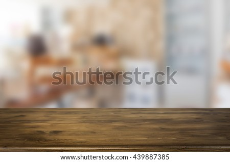 Selected focus empty brown wooden table and space of Coffee shop blur background with bokeh image, for product display montage