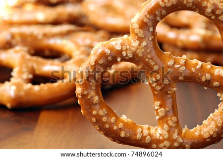 Selected pretzel up close with additional pretzels in soft focus in background.  Macro with extremely shallow dof. - stock photo