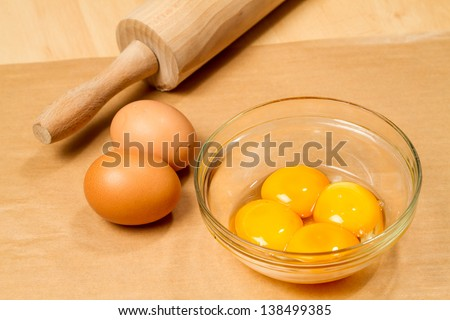 Selecting ingredients for cake, extracting egg whites and yolks