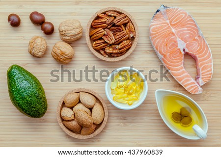 Selection food sources of omega 3 and unsaturated fats. Super food high omega 3 and unsaturated fats for healthy food. Almond ,pecan ,hazelnuts,walnuts ,olive oil ,fish oil ,salmon and avocado . - stock photo