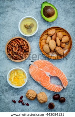 Selection food sources of omega 3 and unsaturated fats. super food high omega 3 and unsaturated fats for healthy food. Almond ,pecan ,hazelnuts,walnuts ,olive oil ,fish oil and avocado . - stock photo