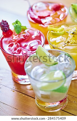 Selection of Brazilian caipirinhas of various fruits                                - stock photo