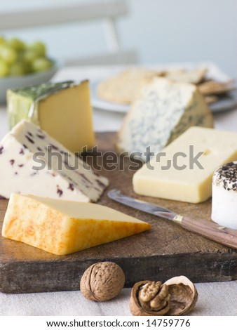 Selection of British Cheeses with Walnuts Biscuits and Grapes