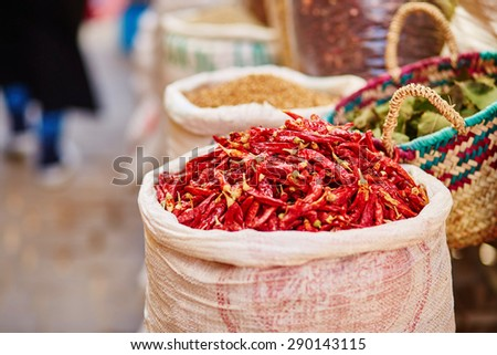 Selection of chili peppers on a traditional Moroccan market (souk) in Fes, Morocco - stock photo