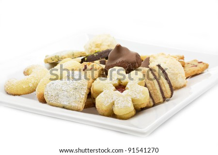Selection of christmas cookies on a white plate