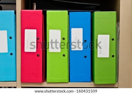 Selection of colorful box files in a home office