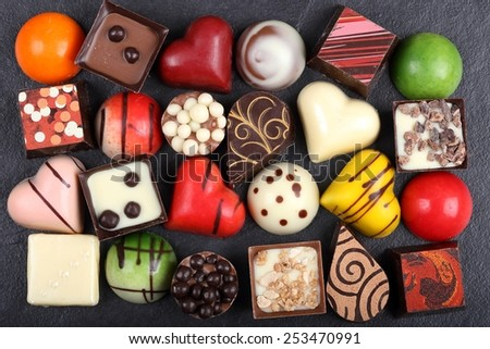 Selection of colorful chocolate candy  in heart shape. - stock photo