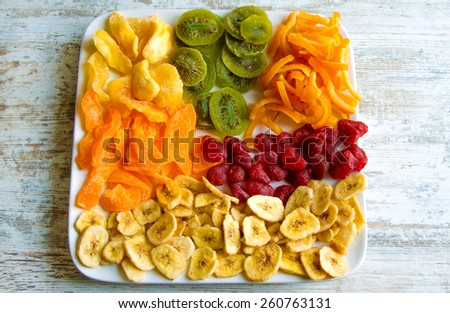 Selection of colorful dried fruits on a plate  - stock photo