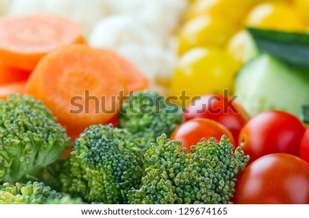 Selection of colorful healthy vegetables; carrots, broccoli, tomatoes, cauliflower, cucumber
