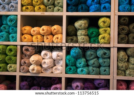 Selection of colorful yarn wool on display in a shop - stock photo