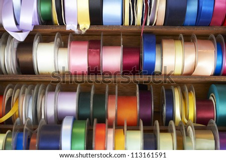 Selection Of Colourful Ribbons On Haberdashery Stall - stock photo