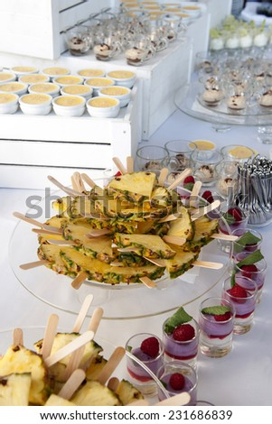 Selection of decorative desserts and fruits on a buffet table