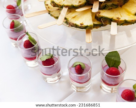 Selection of decorative desserts and fruits on a buffet table - stock photo