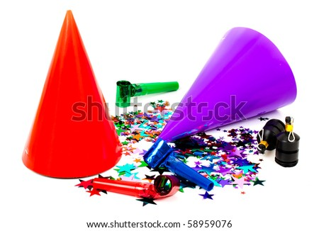 Selection of different brightly colored party items on a white background