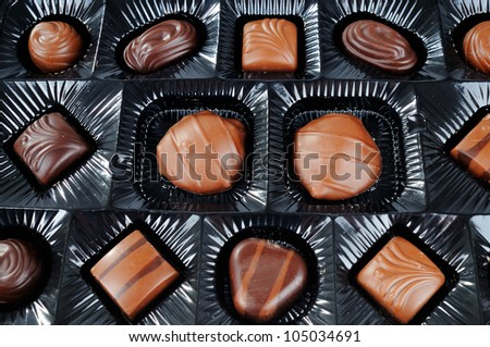 Selection Of Different Chocolate Candies Inside A Box Of Chocolates - stock photo