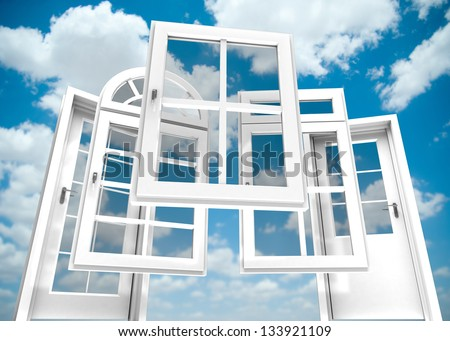 Selection of doors and windows with a blue sky on the background - stock photo