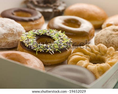 Selection Of Doughnuts In A Tray - stock photo