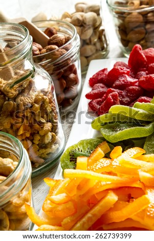 Selection of dried fruits in jars and on a plate