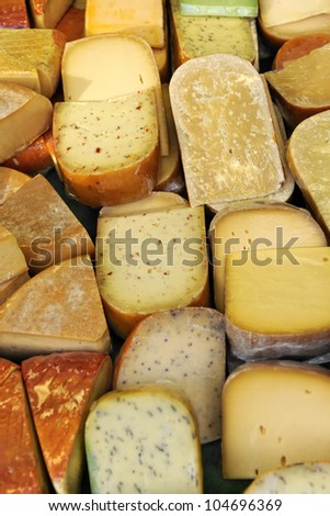 Selection of dutch cheeses for sale at Albert Cuypmarkt market, Amsterdam, Netherlands, Europe - stock photo