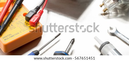 Selection Of Electrical Contractors Tools Including Wire Cutters Multimeter Screwdrivers And A Light