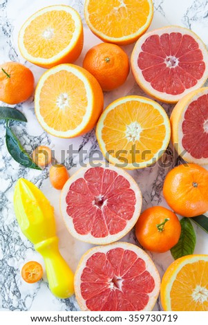 Selection of fresh citrus fruits ripe for making juice - stock photo