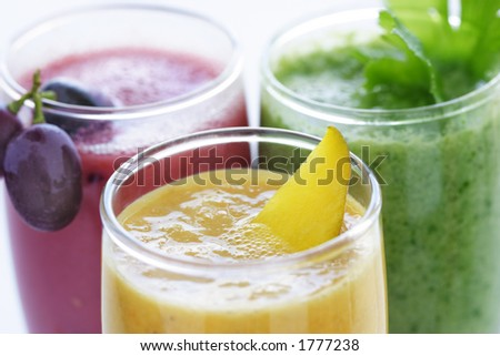 selection of fresh  fruit and vegetables smoothies - stock photo