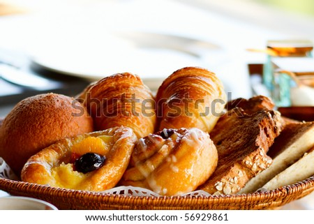 Selection of freshly made breads served for breakfast - stock photo