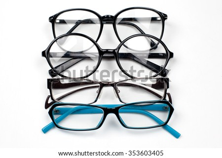 Selection of glasses. Eyeglass frames of various shapes on a white background.