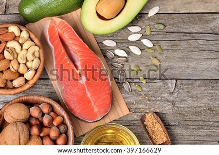Selection of healthy fat sources on wooden table. Copyspace background. Top view.  - stock photo