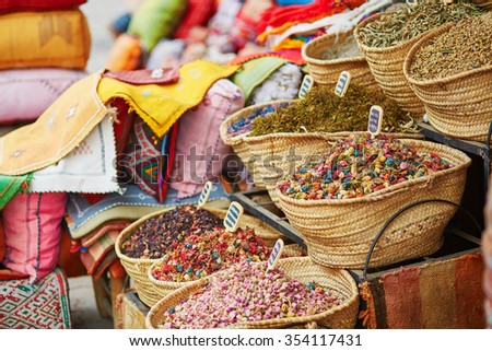 Selection of herbs and dry flowers on a traditional Moroccan market (souk) in Marrakech, Morocco - stock photo