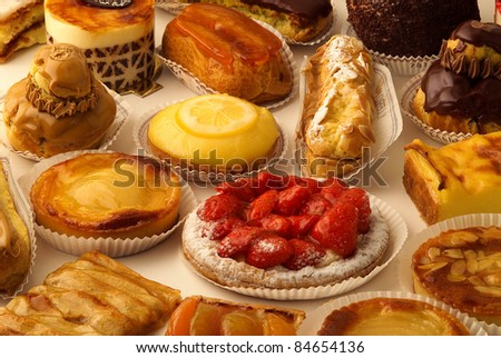 Selection of individual tarts and desserts - stock photo
