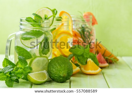 selection of infused water for detox, wood background