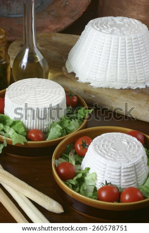selection of italian fresh cheese and ricotta on wood background  - stock photo