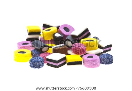 Selection of liquorice sweets in colourful abstract stack design isolated over white background. - stock photo