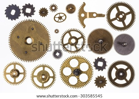 Selection of old brass clockwork clock parts - Isolated - stock photo